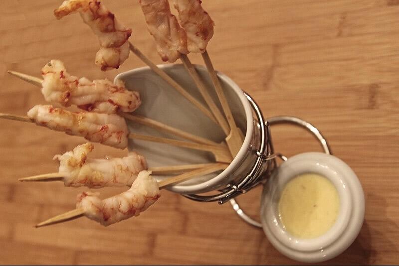 Crevettes au beurre, orange & gingembre